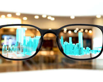 Pair of glasses with a projection of a city inside